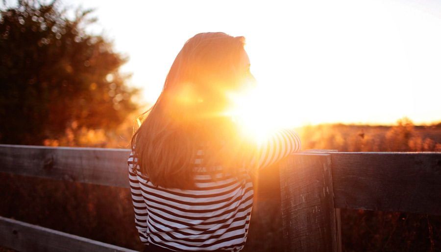 Woman with Breast Cancer looking at sunset