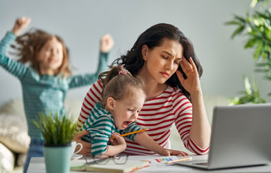 stressed-out woman with two screaming kids
