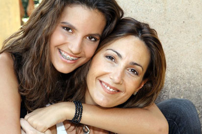 Mother and daughter hugging, benefit from Fractora for acne scars