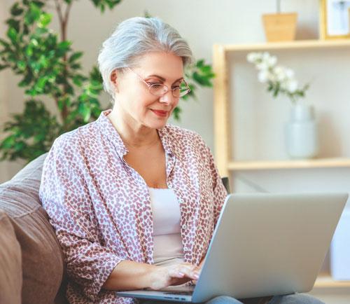 Woman using telehealth on a laptop